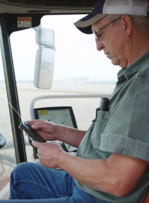 Image of farmer using phone